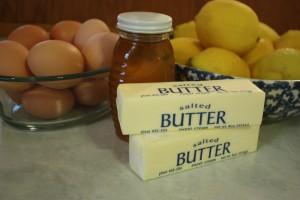 sticks of butter, jar of honey, eggs, lemons