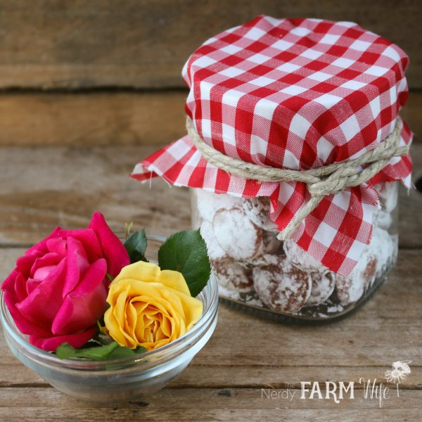 rose petal peppermint drops in a jar with fresh roses