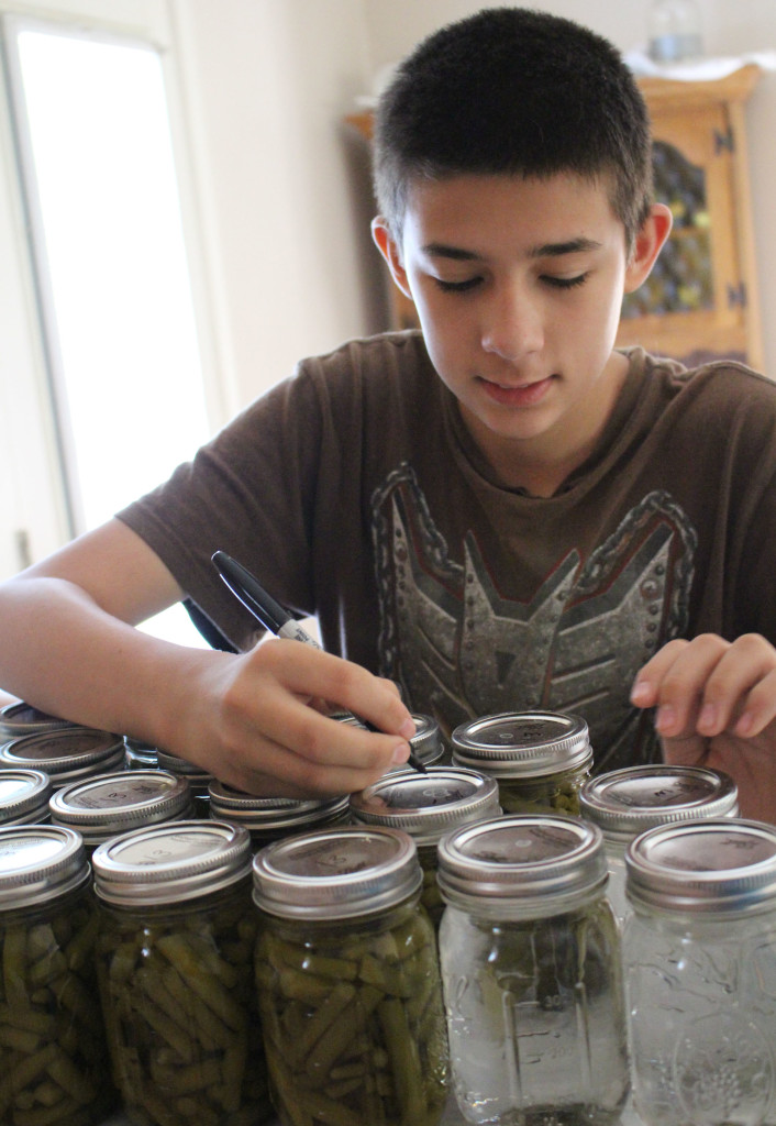 labeling canned water and green beans