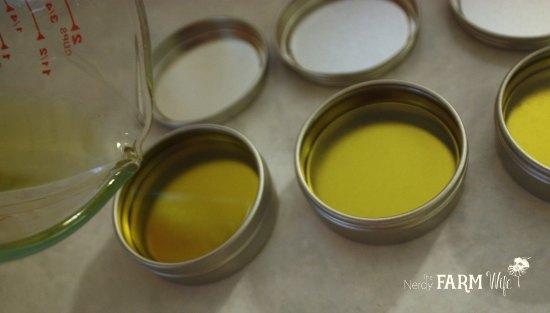 Pouring Violet Leaf Balm into Tins