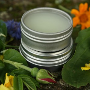 a stack of tins with balm