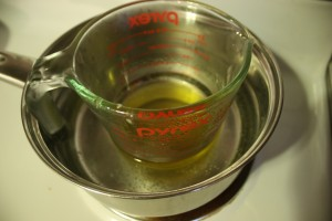 a cup of oil in a saucepan