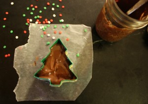 Pouring chocolate over peanut butter tree
