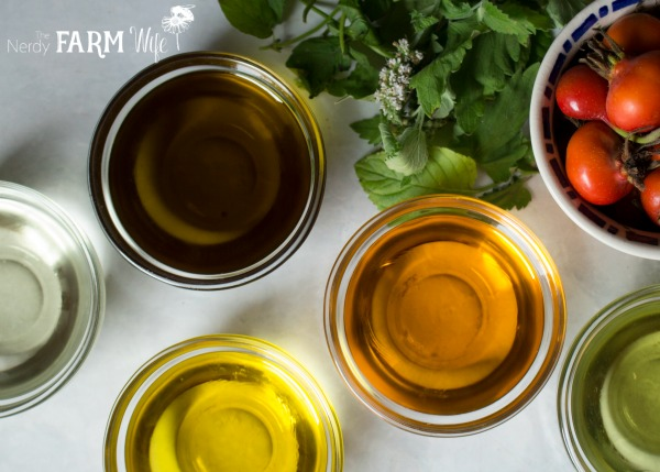 a variety of oils to make DIY Herbal Lip Balms