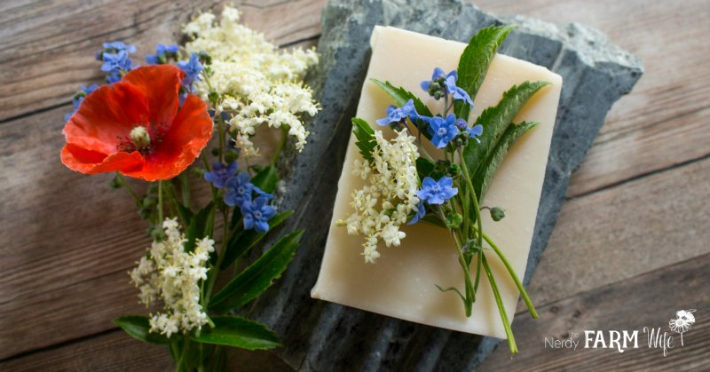 bar of handmade soap with red, white and blue flowers
