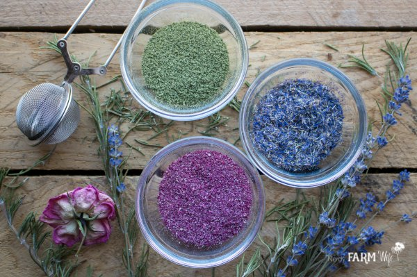 glass bowls of ground herbs and flowers