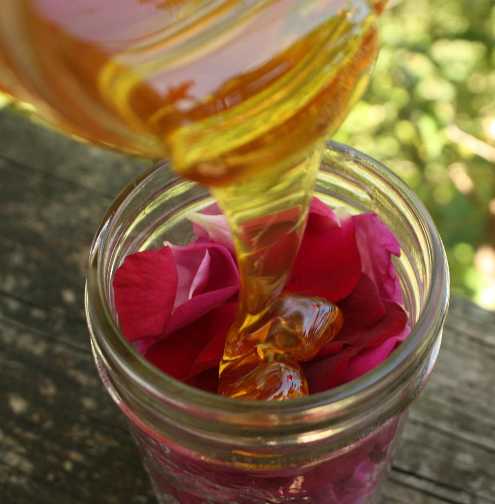 Pouring honey over rose petals