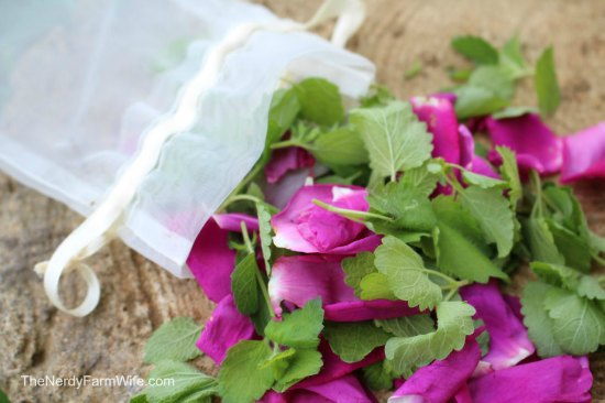 bath bag filled with fresh rose petals and fresh lemon balm leaves