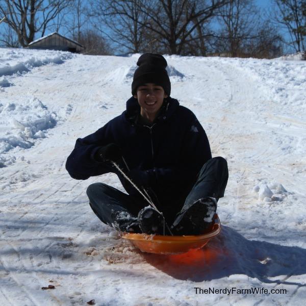 sledding in the snow