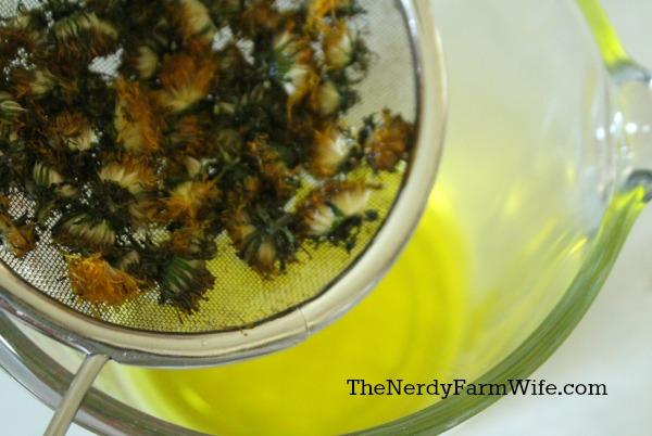 Straining dandelions from coconut oil