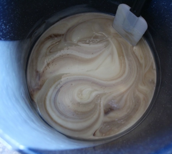 Mixing cocoa into milk soap batter