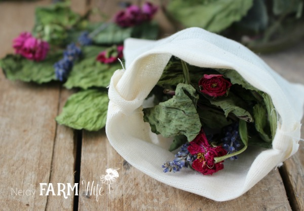 muslin bath bag filled with dried herbs and flowers