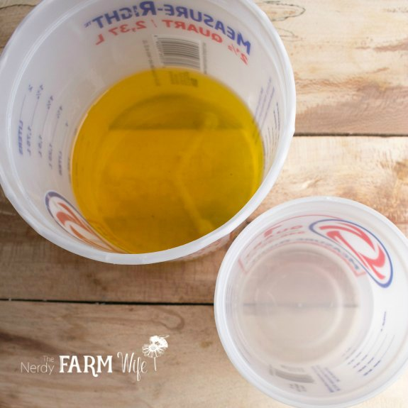 plastic containers of dandelion oil and lye solution