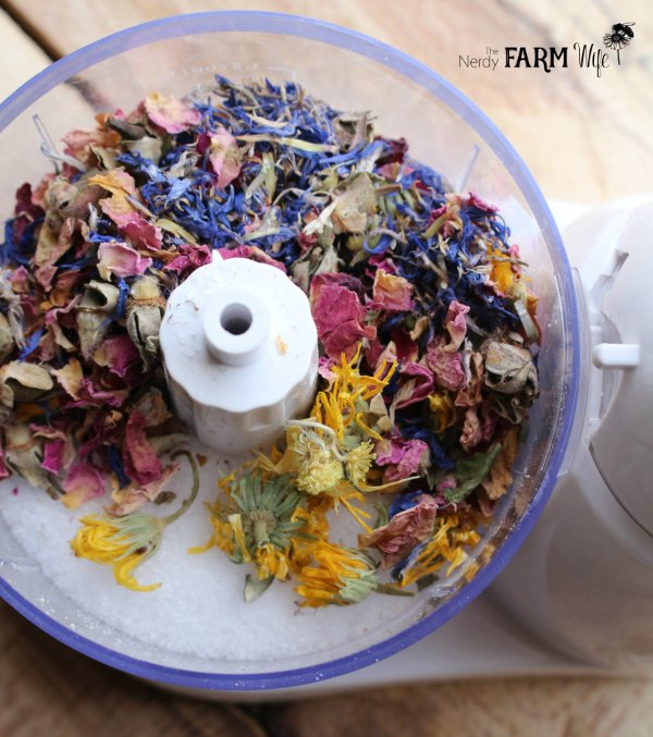 a food processor with salt and dried flowers