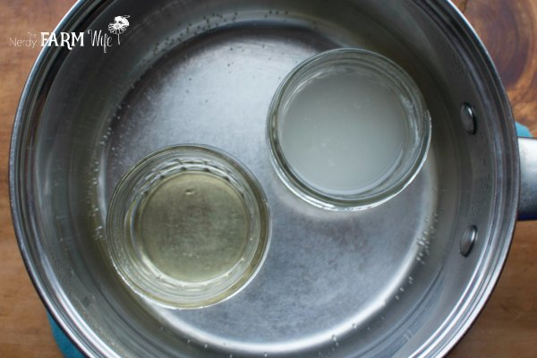 two jars in a saucepan of water