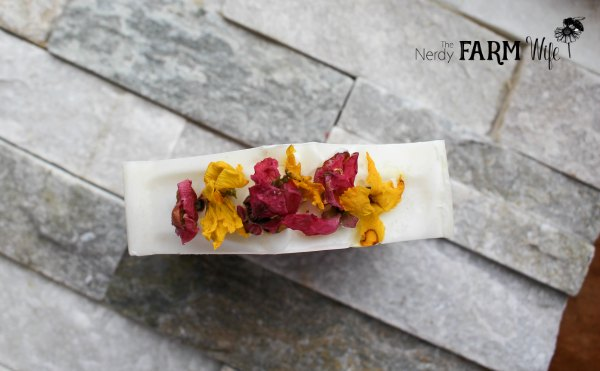 natural soap topped with dried forsythia and quince flowers
