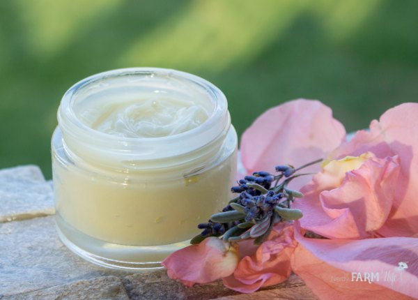Lavender Rose Balm in a glass jar with rose petals and lavender
