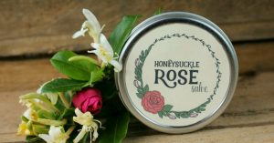 a tin of honeysuckle rose salve