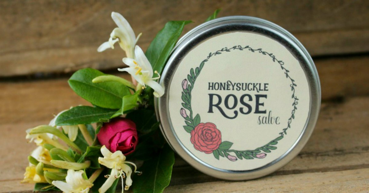 a tin of honeysuckle rose salve