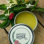 Honeysuckle Rose Salve Recipe - Roses are often used in skin care recipes for theircooling and anti-inflammatory properties. Honeysuckle flowers, while better known for treating flu and virusesinternally, can also be used as a skin soothing component in skin care formulations. Dab the salve on dry, itchy or irritated spots - a little goes a long way!