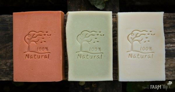 a row of three natural face soaps