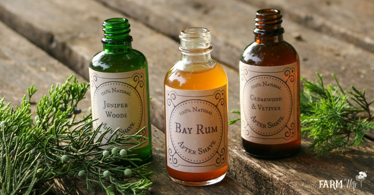 row of bottles filled with natural homemade aftershaves - bay rum, juniper woods, and cedarwood vetiver