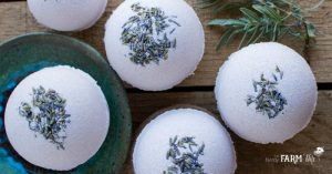 Lavender Bath Bombs on a wooden board with fresh lavender leaves