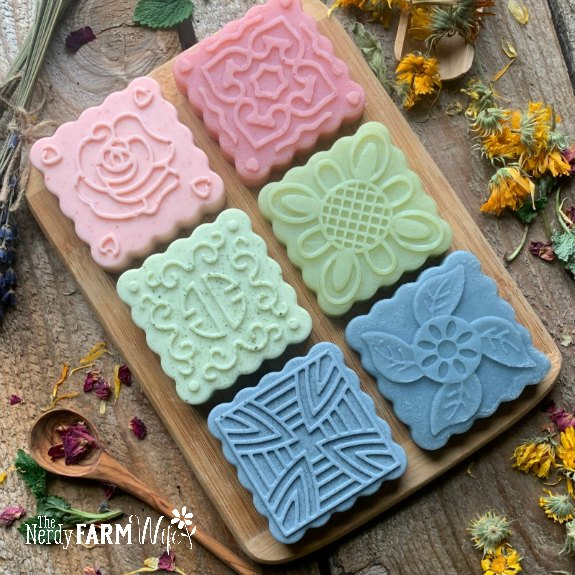 A variety of natural soaps on a wooden table