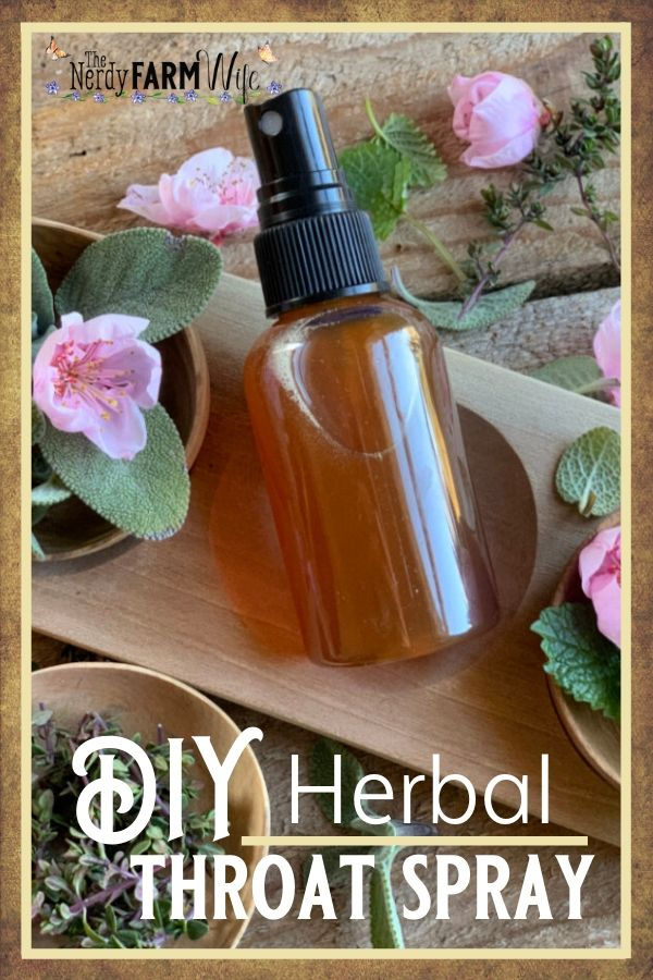 DIY Herbal Throat Spray surrounded by fresh thyme, sage, and lemon balm leaves, and fresh peach blossoms