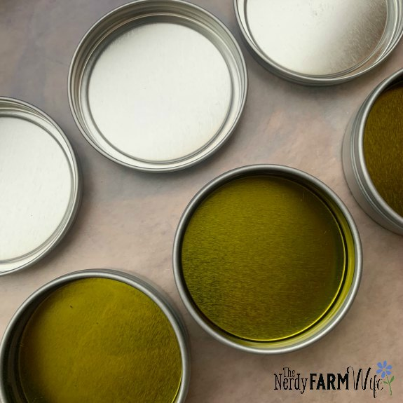 freshly filled tins of salve