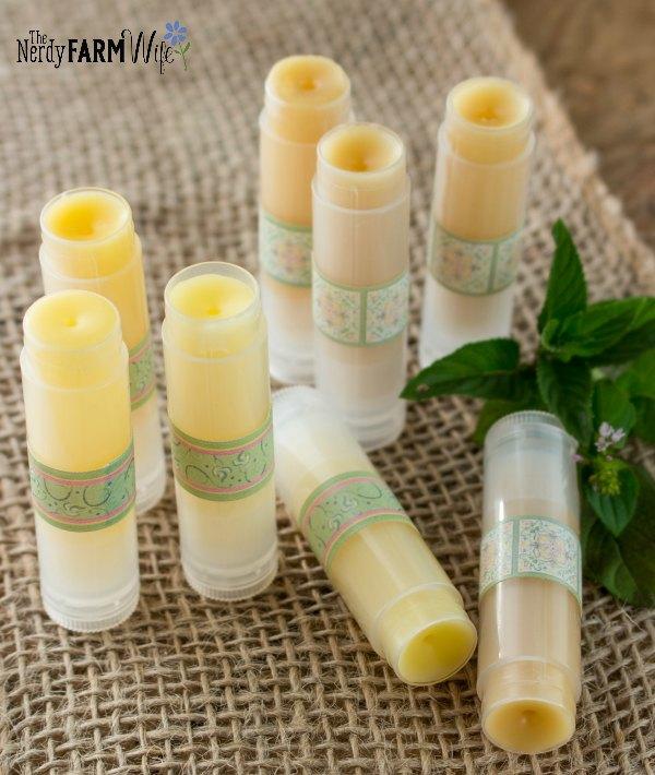 tubes of lip balm on burlap background
