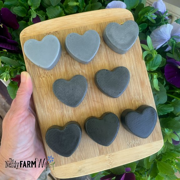 wooden board with multiple heart shaped soaps