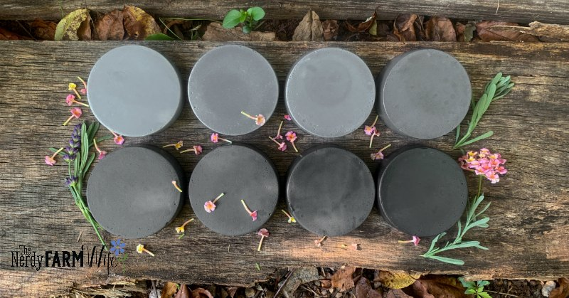 two rows of charcoal round soaps
