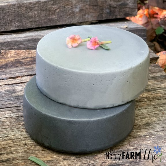 two stacked round soaps made with charcoal
