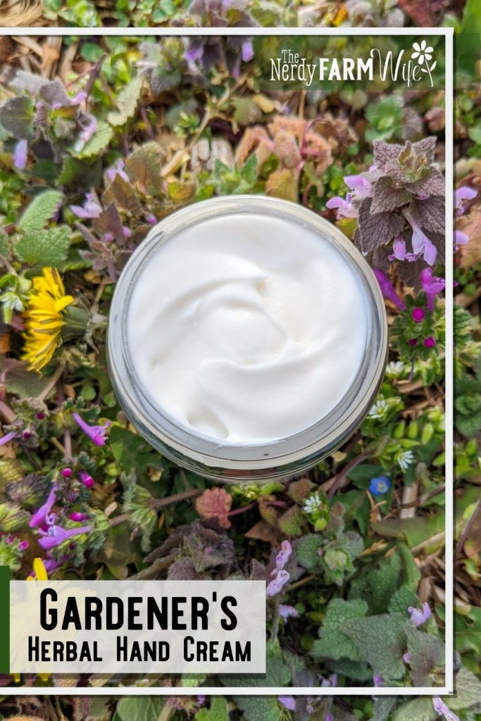jar of hand cream surrounded by weed flowers