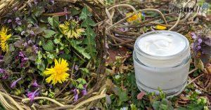 basket of garden weeds and glass jar of hand cream