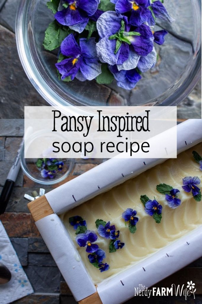 bowl of dried pansies and fresh soap in mold