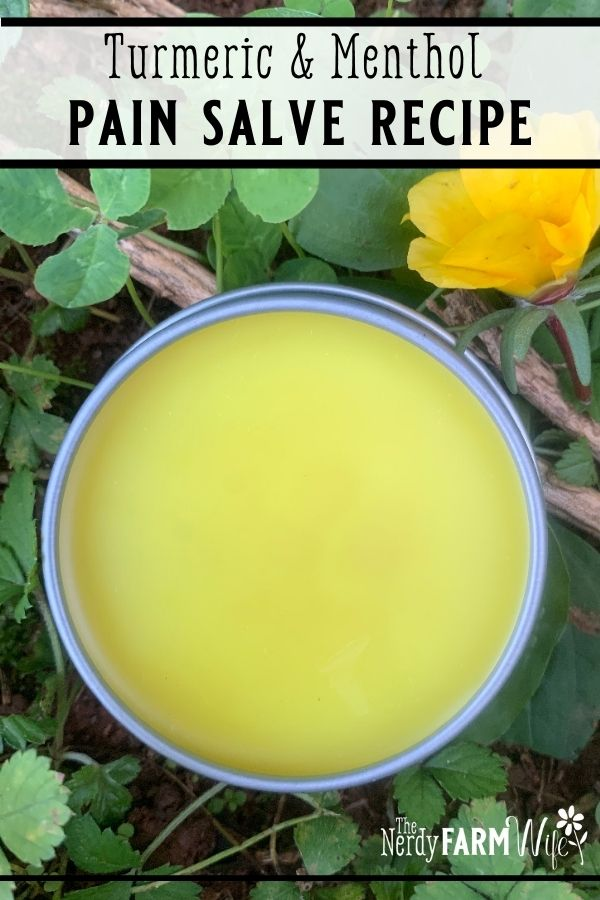 tin of salve on fresh green plant background with yellow flower