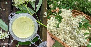 jar of homemade deodorant and basket of fresh elderflowers