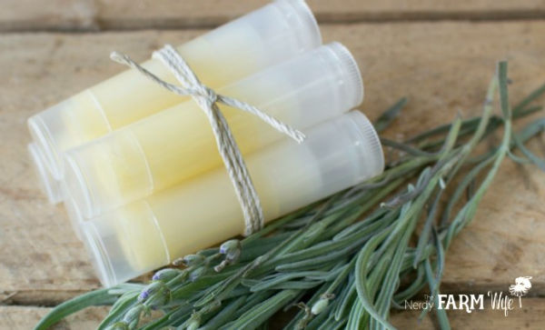 several bug bite sticks in lip balm tubes tied together with a piece of twine on wooden background
